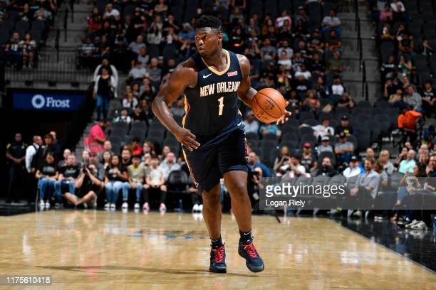 Zion Williamson of the New Orleans Pelicans handles the ball against the San Antonio Spurs during a pre-season game on October 13, 2019 at the AT&T...