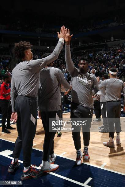 Zion Williamson of the New Orleans Pelicans high fives his teammate before the game against the Minnesota Timberwolves on March 8 2020 at Target...