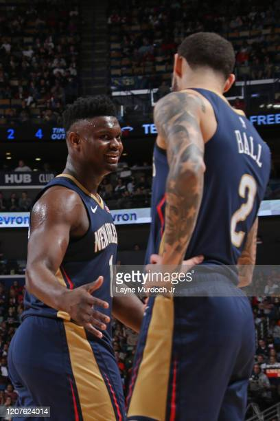 Zion Williamson of the New Orleans Pelicans highfives Lonzo Ball of the New Orleans Pelicans on March 6 2020 at the Smoothie King Center in New...
