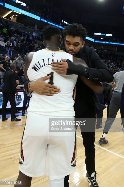 Zion Williamson of the New Orleans Pelicans hugs with KarlAnthony Towns of the Minnesota Timberwolves after the game on March 8 2020 at Target Center...