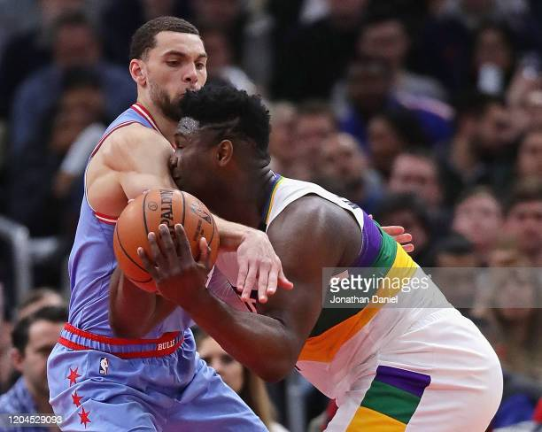 Zion Williamson of the New Orleans Pelicans is fouled by Zach LaVine of the Chicago Bulls at the United Center on February 06, 2020 in Chicago,...