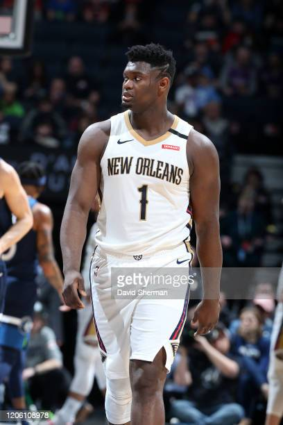 Zion Williamson of the New Orleans Pelicans looks on during the game against the Minnesota Timberwolves on March 8 2020 at Target Center in...