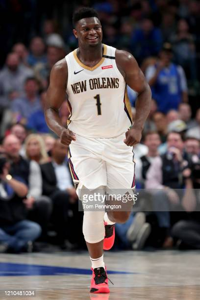 Zion Williamson of the New Orleans Pelicans reacts against the Dallas Mavericks in the second quarter at American Airlines Center on March 04, 2020...
