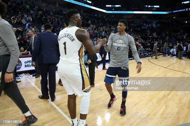 Zion Williamson of the New Orleans Pelicans shakes hands with Jarrett Culver of the Minnesota Timberwolves after the game on March 8 2020 at Target...