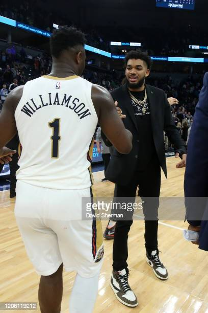 Zion Williamson of the New Orleans Pelicans shakes hands with KarlAnthony Towns of the Minnesota Timberwolves after the game on March 8 2020 at...