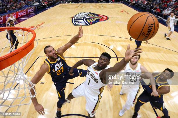 Zion Williamson of the New Orleans Pelicans shoots against Rudy Gobert of the Utah Jazz during the second half of a game at the Smoothie King Center...