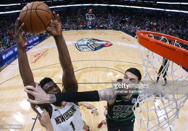 Zion Williamson of the New Orleans Pelicans shoots against Vincent Poirier of the Boston Celtics during the second half at the Smoothie King Center...