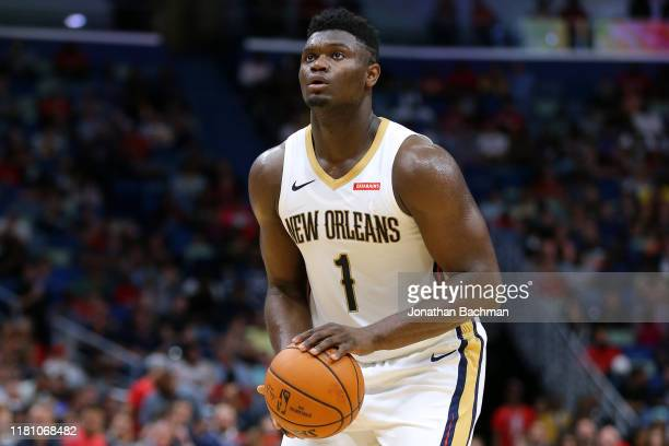 Zion Williamson of the New Orleans Pelicans shoots during a preseason game against the Utah Jazz at the Smoothie King Center on October 11 2019 in...