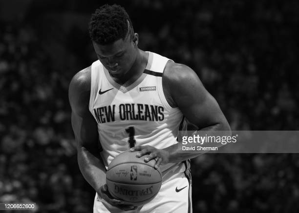 Image has been converted to black and white Zion Williamson of the New Orleans Pelicans shoots free throws on March 8 2020 at Target Center in...