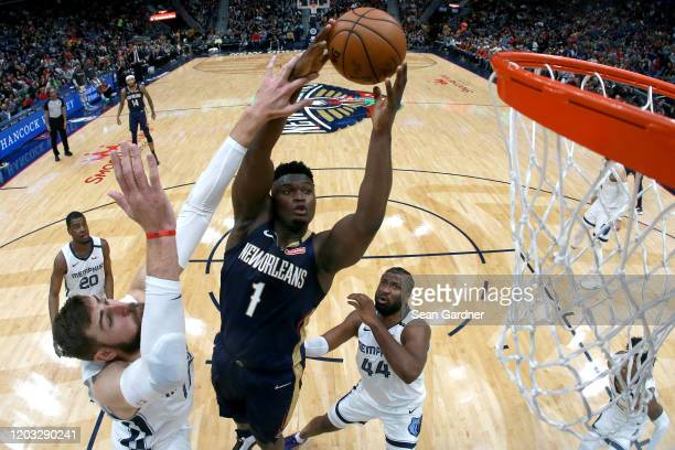 Zion Williamson of the New Orleans Pelicans shoots over Jonas Valanciunas of the Memphis Grizzlies during a NBA game at Smoothie King Center on...