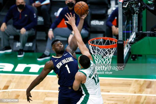 Zion Williamson of the New Orleans Pelicans takes a shot against Grant Williams of the Boston Celtics during the first quarter at TD Garden on March...