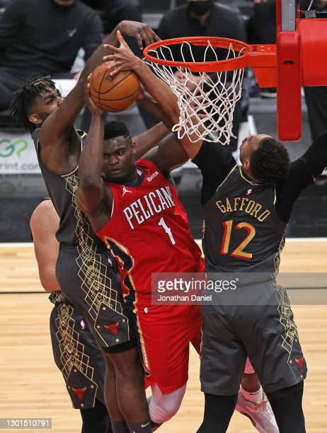 Zion Williamson of the New Orleans Pelicans tries to pass under pressure from Patrick Williams and Daniel Gafford of the Chicago Bulls at the United...