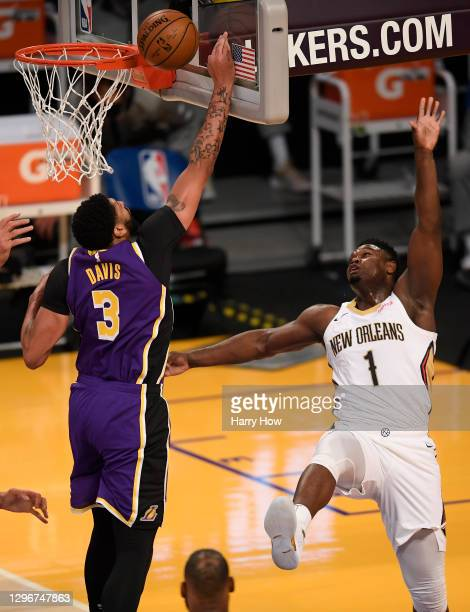 Zion Williamson of the New Orleans Pelicans watches as his shot is blocked by Anthony Davis of the Los Angeles Lakers during a 112-95 Lakers win at...