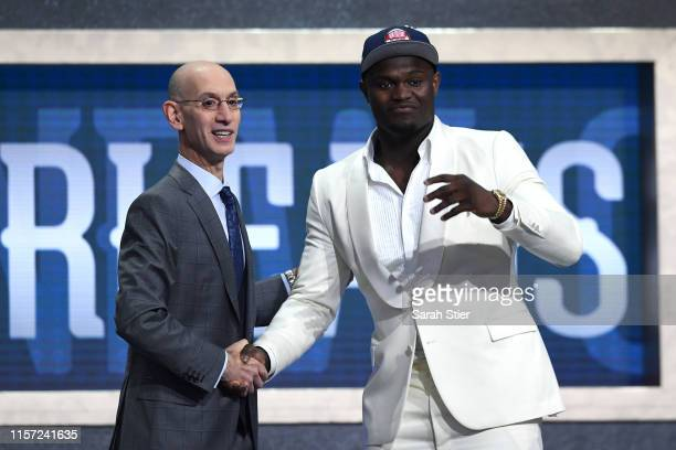 Zion Williamson poses with NBA Commissioner Adam Silver after being drafted with the first overall pick by the New Orleans Pelicans during the 2019...