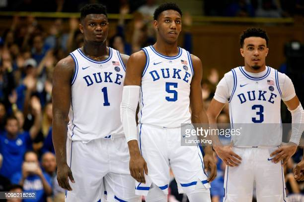 Zion Williamson RJ Barrett and Tre Jones of the Duke Blue Devils look on during their game against the Boston College Eagles at Cameron Indoor...
