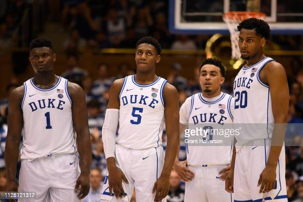 Zion Williamson RJ Barrett Tre Jones and Marques Bolden of the Duke Blue Devils look on during their game against the Boston College Eagles at...