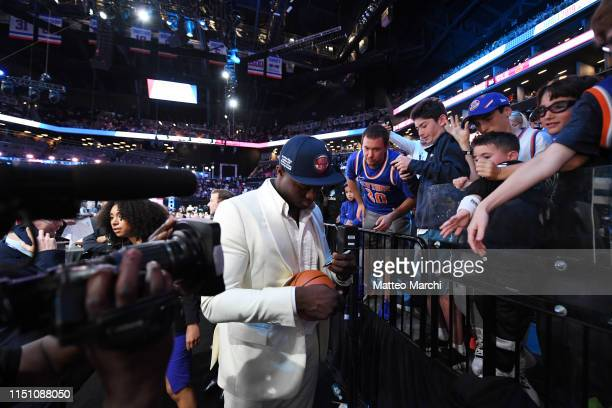 Zion Williamson signs autographs after being selected number one overall by the New Orleans Pelicans during the 2019 NBA Draft on June 20, 2019 at...