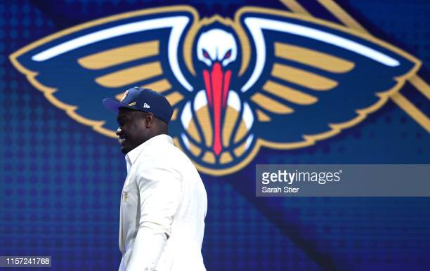 Zion Williamson walks to the stage after being drafted with the first overall pick by the New Orleans Pelicans during the 2019 NBA Draft at the...