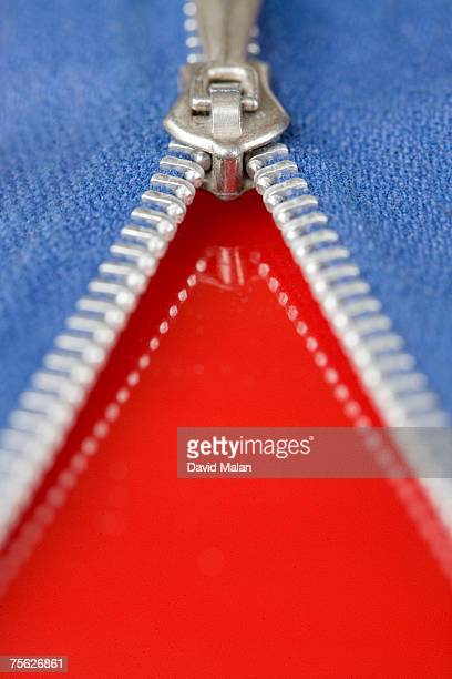 Zip opening blue fabric to reveal red surface