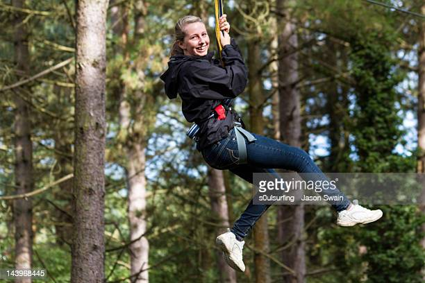 zip wire teenager - s0ulsurfing stock pictures, royalty-free photos & images