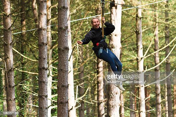zip wire, tree-top adventure trail - s0ulsurfing stock pictures, royalty-free photos & images