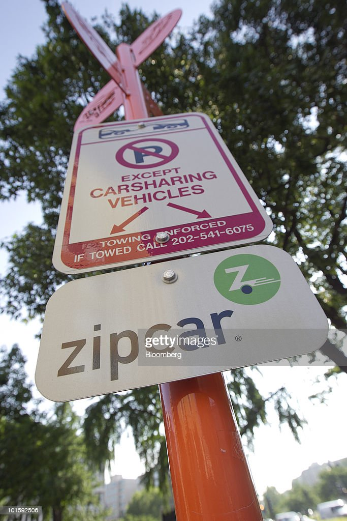 A Zipcar And Car Sharing Sign Stand In Washington D C