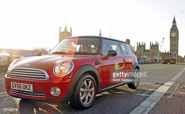 Zipcar is driven past Britain's House of Parliament on December 6 2006 in London England With 80000 consumer and business drivers around the world...