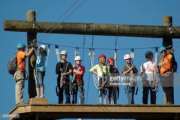 Zipline in Stickly Farm. Tennessee. Kids ready for adventure. Halloween Day. Children having a lot of fun. Radical Sports.