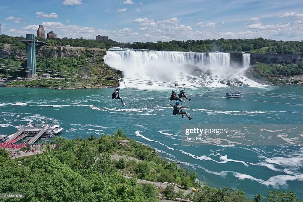 Ziplining by Niagara Falls, a new attraction for thrill seekers, a fun way to experience the natural wonder : Stock Photo
