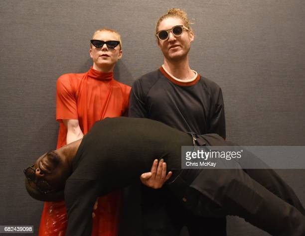 Zipper Club's Lissy Trullie and Mason James carry Damar Davis as they pose for portraits backstage at Shaky Knees Music Festival at Centennial...