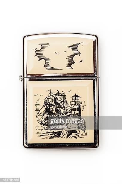zippo scrimshaw lighter - cigarette lighter stock pictures, royalty-free photos & images