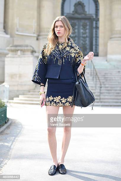 Zita De Hauteville poses wearing Blumarine jacket and skirt and Celine bag on Day 9 of Paris Fashion Week Womenswear FW15 on March 11 2015 in Paris...