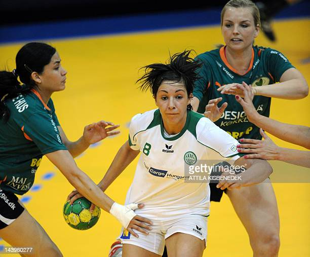 Zita Szucsanszki of Hungarian FTC Rail Cargo fights for the ball with Mouna Chebbah and Johanna Ahlm of Danish HK Viborg in the Diego sports hall of...
