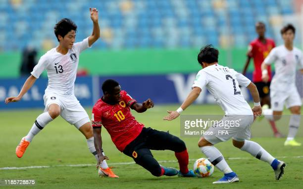 Zito of Angola challenges Ryunseong Kim of Korea Republic during the FIFA U-17 World Cup Brazil 2019 round of 16 match between Angola and Korea...
