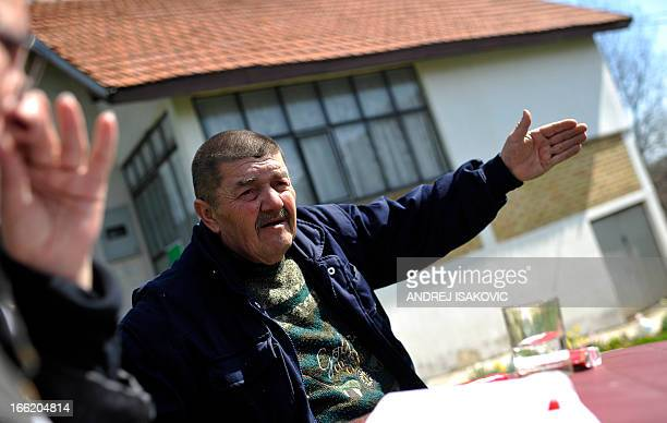 Zivomir Stancevic, brother in law of the alleged gunman Ljubisa Bogdanovic, talks to a journalist in the village of Velika Ivanca, 40 kilometres...