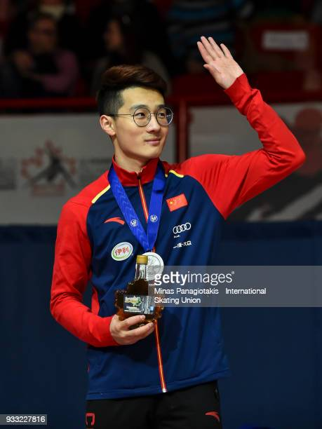 Ziwei Ren of China acknowledges the fans after finishing second to capture the silver medal in the men's 500 meter Final during the World Short Track...