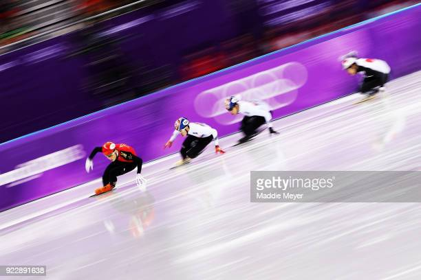 Ziwei Ren of China and Hyojun Lim of Korea lead their Men's 500m Short Track Speed Skating Semi Final on day thirteen of the PyeongChang 2018 Winter...