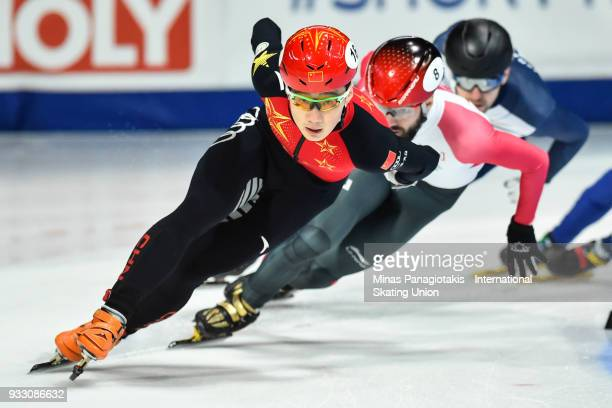 Ziwei Ren of China competes in the men's 1500 meter semifinals during the World Short Track Speed Skating Championships at Maurice Richard Arena on...