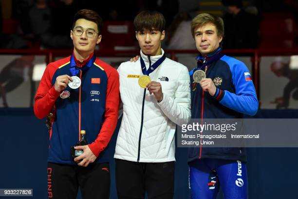 Ziwei Ren of China Dae Heon Hwang of Korea and Semen Elistratov of Russia hold up their medals after completing the men's 500 meter Final during the...