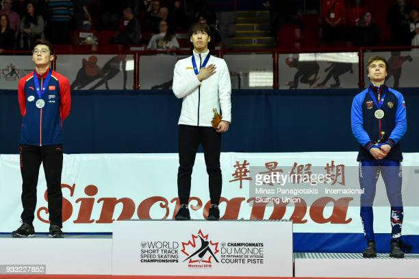 Ziwei Ren of China Dae Heon Hwang of Korea and Semen Elistratov of Russia stand as the Korean anthem is played in the medal ceremony of the men's 500...