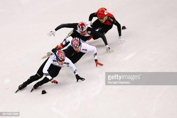 Ziwei Ren of China Hyojun Lim of Korea Daeheon Hwang of Korea and Ryosuke Sakazume of Japan compete during the Short Track Speed Skating Men's 500m...