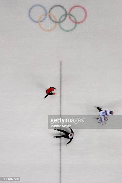 Ziwei Ren of China Hyojun Lim of Korea Daeheon Hwang of Korea compete as Ryosuke Sakazume of Japan falls during the Short Track Speed Skating Men's...
