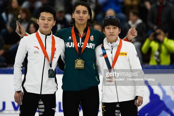 Ziwei Ren of China Shaolin Sandor Liu of Hungary and Ji Won Park of Korea pose for a photo after the men's 1000m final during ISU World Cup Short...