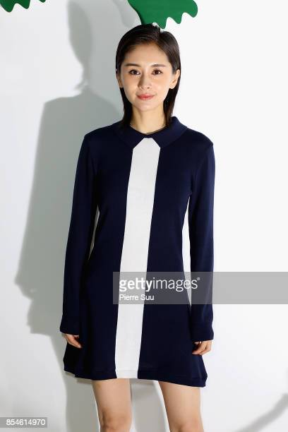 Ziwen Wang attends the Lacoste show as part of the Paris Fashion Week Womenswear Spring/Summer 2018 on September 27 2017 in Paris France