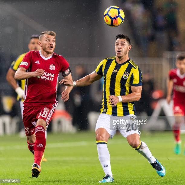Ziya Erdal of Demir Grup Sivasspor Giuliano Victor de Paula of Fenerbahce SK during the Turkish Spor Toto Super Lig football match between Fenerbahce...