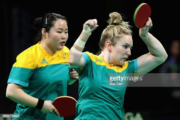 Ziyu Zhang and Melissa Tapper of Australia play a shot to North Korea during the Women's Team Round 1 table tennis on Day 7 of the Rio 2016 Olympic...