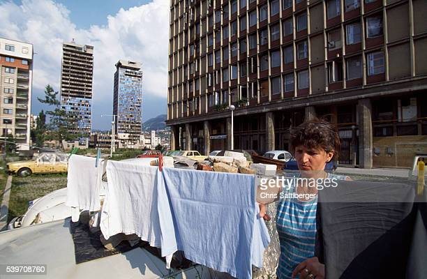Zlata Homeras hangs washing on a line in the middle of wartorn Sarajevo