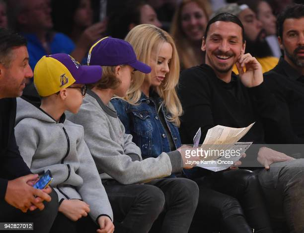 Zlatan Ibrahimovi of the Los Angeles Galaxy attends the game between the Los Angeles Lakers and the Minnesota Timberwolves with his wife Helena...
