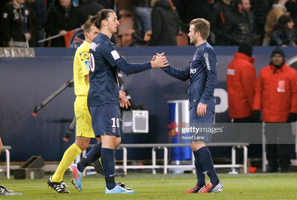 Zlatan Ibrahimovic and David Beckham of Paris Saint-Germain celebrate the victory after the French League 1 between Paris Saint-Germain FC and Montpellier Herault SC, at Parc des Princes on March 29, 2013 in Paris, France.