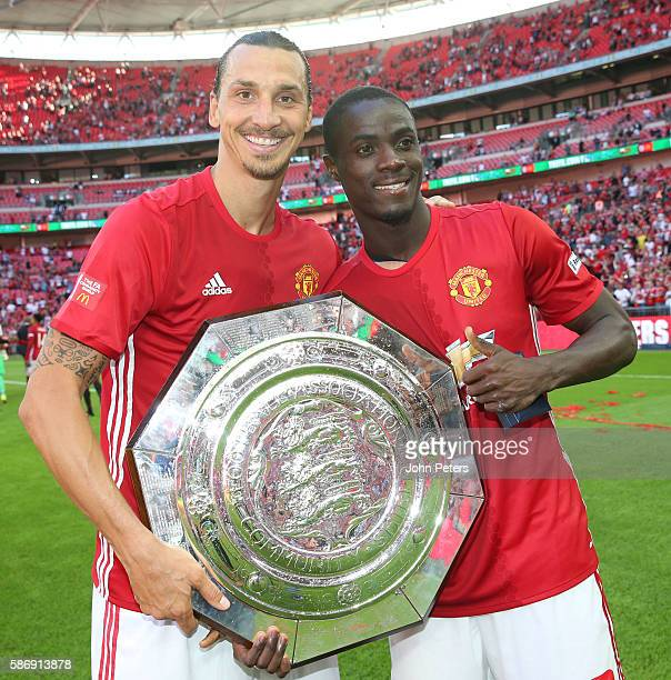 Zlatan Ibrahimovic and Eric Bailly of Manchester United pose with the Community Shield trophy after the FA Community Shield match between Leicester...